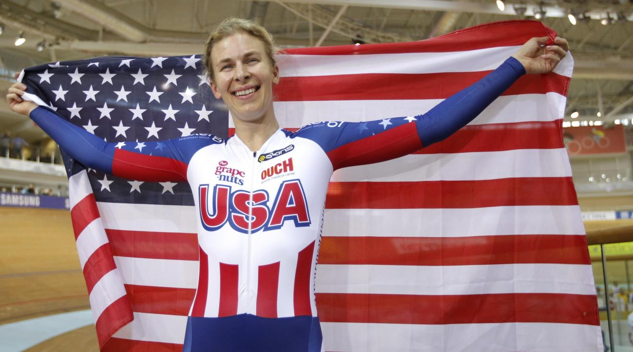 FILE - In this Feb. 24, 2013 file photo, Gold medalist Sarah Hammer, of USA, celebrates her win at the Women's Omnium during the Track Cycling World Championships in Minsk, Belarus.  USA Cycling has pushed the limits of training technology in the run-up t