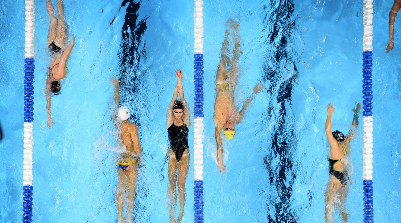 Swimmers warm up prior to preliminaries at the U.S. Olympic swimming trials, Monday, June 27, 2016, in Omaha, Neb. (AP Photo/Mark J. Terrill)