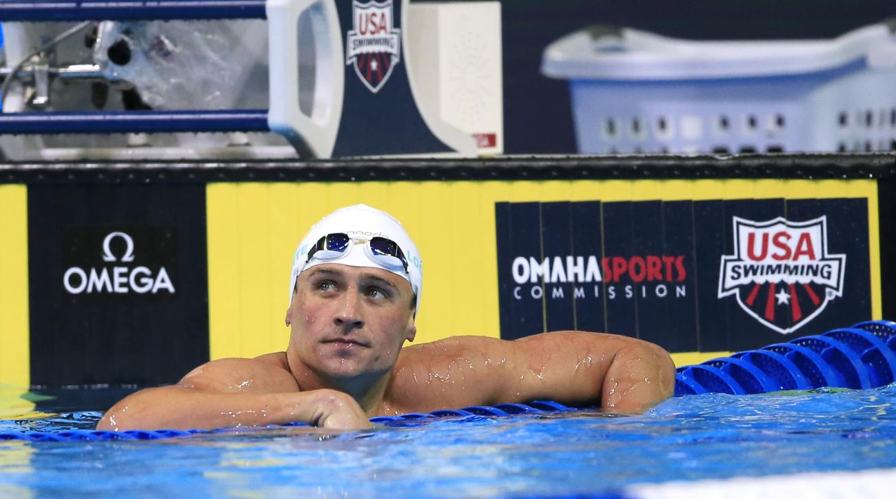 Ryan Lochte checks the clock after swimming in the men's 200-meter freestyle preliminaries at the U.S. Olympic swimming trials, Monday, June 27, 2016, in Omaha, Neb. (AP Photo/Orlin Wagner)
