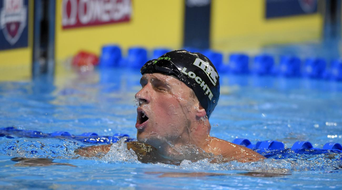 Ryan Lochte reacts after a men's 200-meter freestyle semifinal at the U.S. Olympic swimming trials, Monday, June 27, 2016, in Omaha, Neb. (AP Photo/Mark J. Terrill)