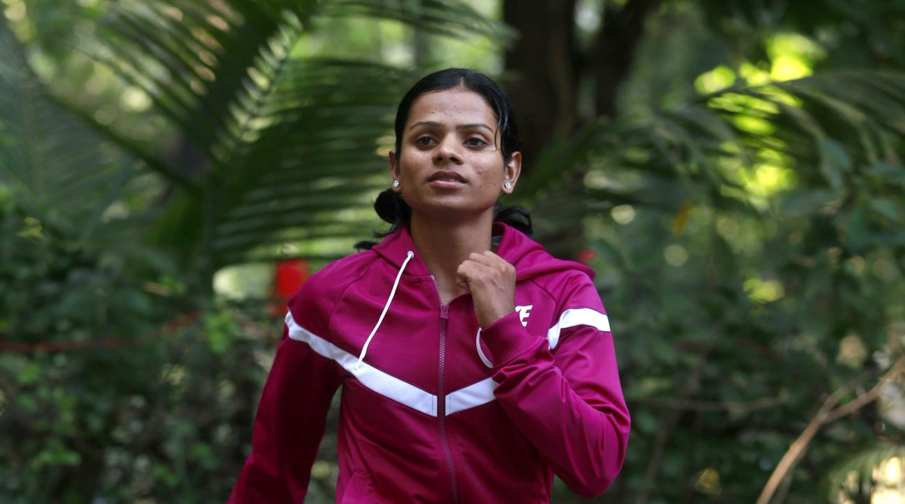 FILE - In this Oct. 29, 2014 file photo, Indian athlete Dutee Chand poses for the Associated Press in Mumbai, India. The Indian sprinter has qualified for the Olympics after the Court of Arbitration for Sport issued a landmark ruling that challenged her s
