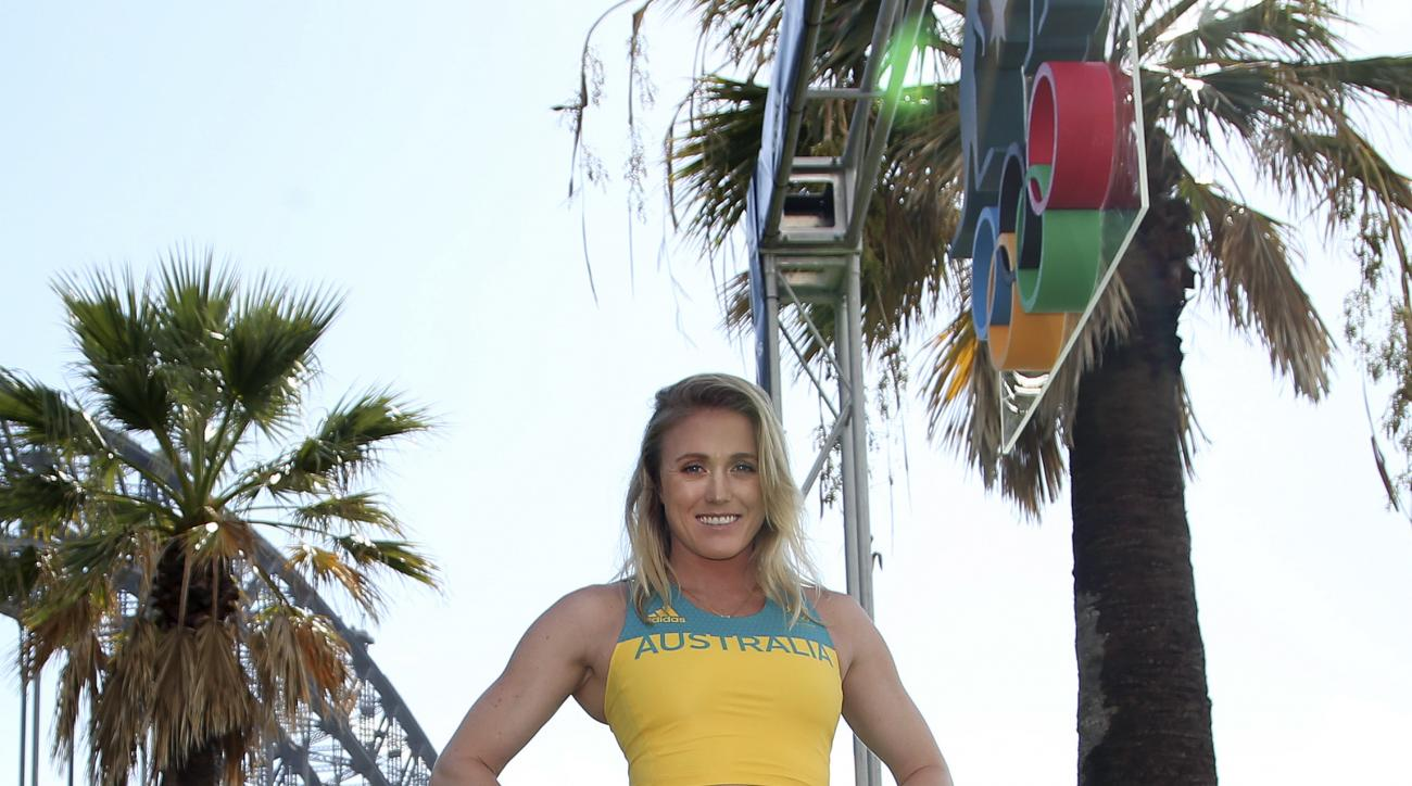 FILE - In this April 19, 2016 file photo, champion hurdler Sally Pearson models one of the uniforms the Australian Olympic team will wear for the Rio 2016 Olympics, in Sydney. Hurdles gold medalist Pearson has reportedly withdrawn from the Olympics in Rio