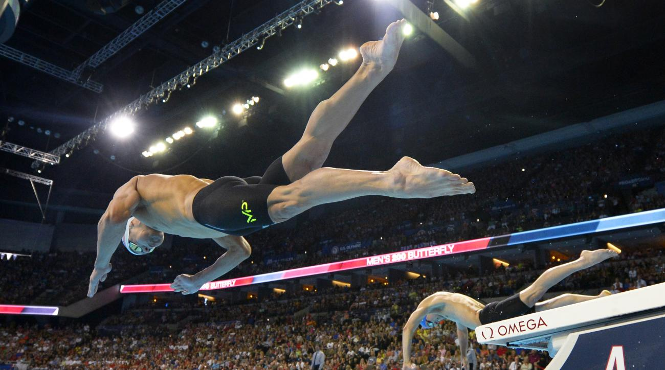 Michael Phelps dives at the start of a men's 200-meter butterfly semifinal at the U.S. Olympic swimming trials, Tuesday, June 28, 2016, in Omaha, Neb. (AP Photo/Mark J. Terrill)