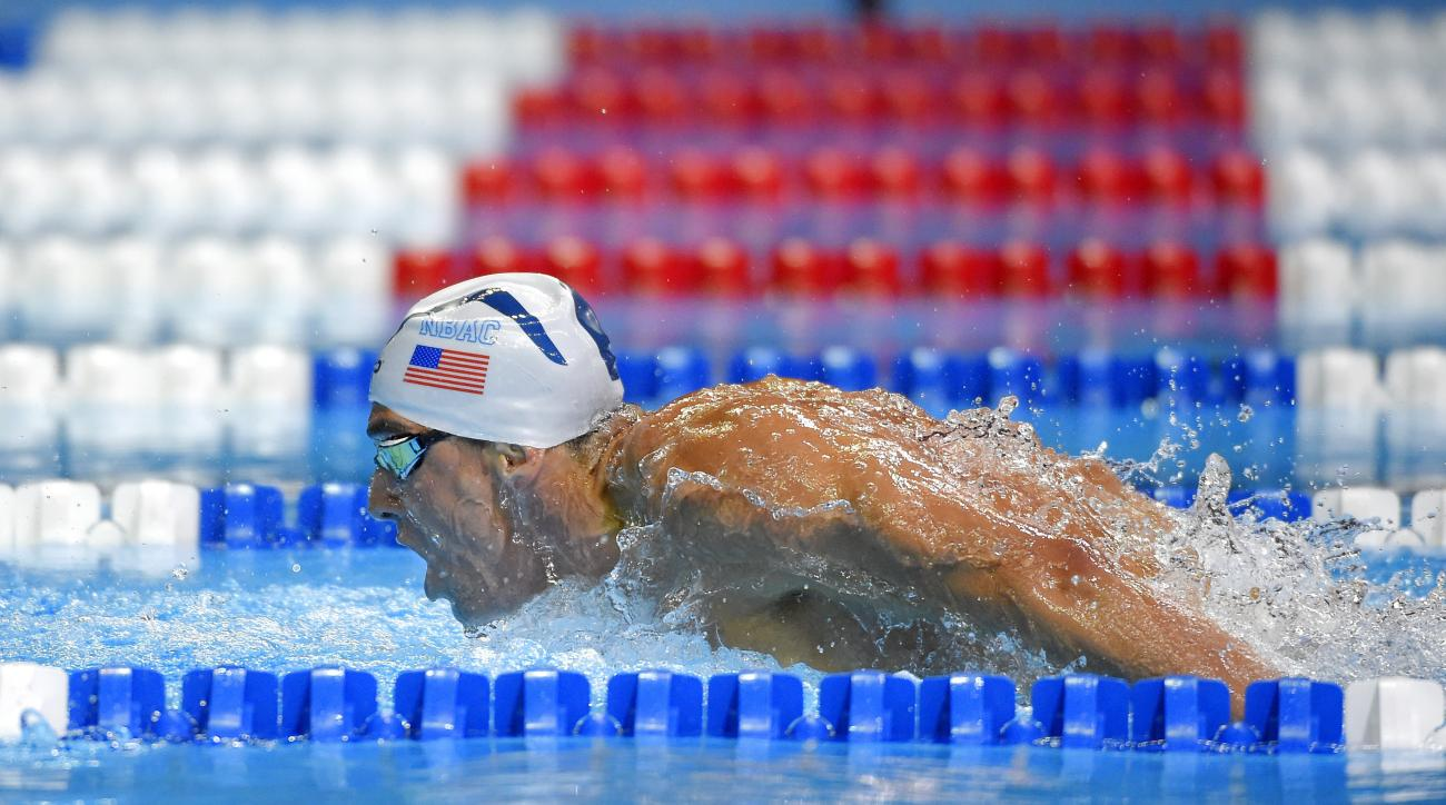 Michael Phelps swims in a men's 200-meter butterfly semifinal at the U.S. Olympic swimming trials, Tuesday, June 28, 2016, in Omaha, Neb. Phelps won the semifinal. (AP Photo/Mark J. Terrill)