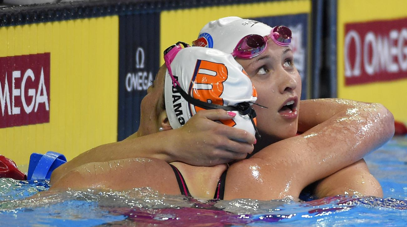 Cassidy Bayer, right, hugs Cammile Adams, left, after their heat in the women's 200-meter butterfly preliminaries at the U.S. Olympic swimming trials, Wednesday, June 29, 2016, in Omaha, Neb. (AP Photo/Mark J. Terrill)