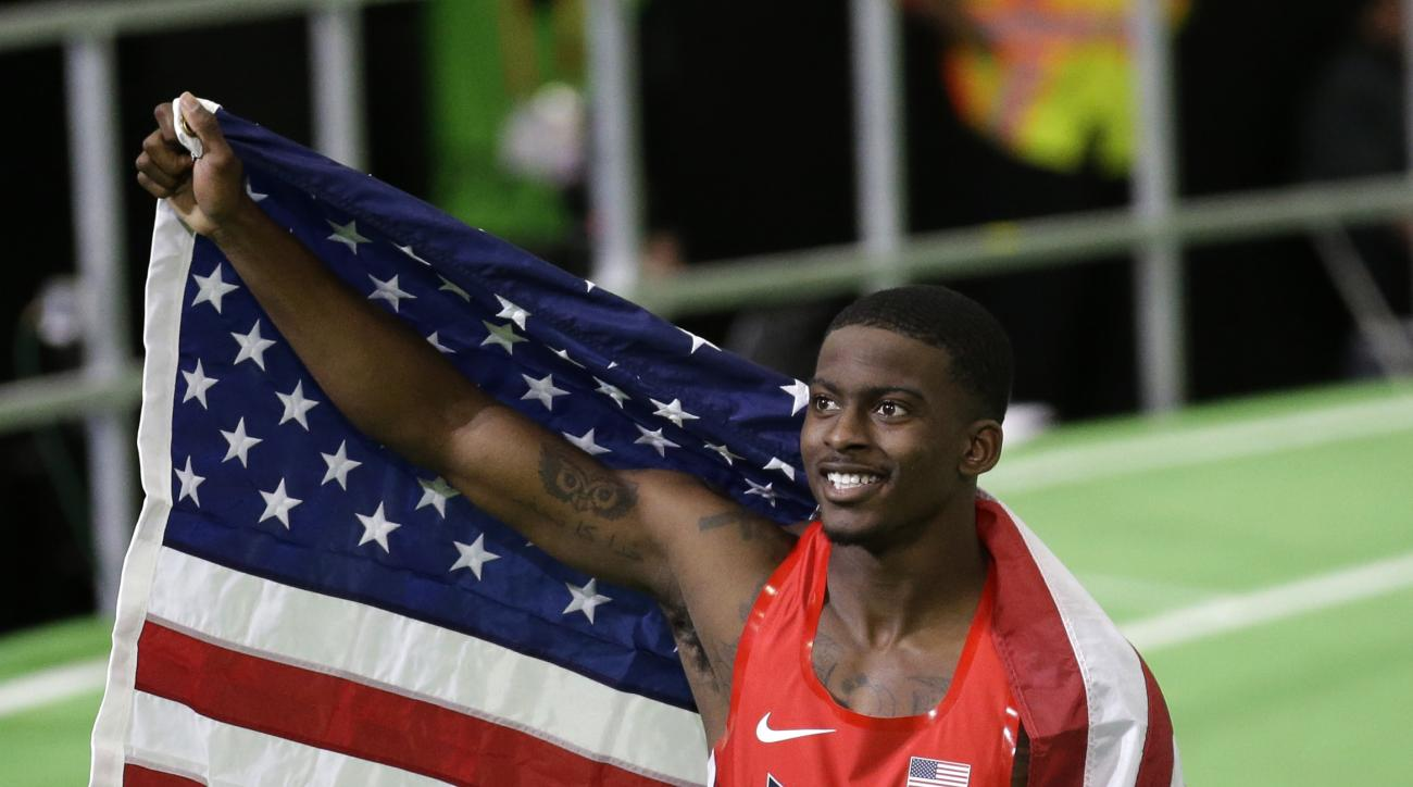 FILE - In this March 18, 2016, file photo, United States' Trayvon Bromell celebrates after winning the men's 60-meter sprint final during the World Indoor Athletics Championships in Portland, Ore. Bromell nearly gave up track after breaking his right knee