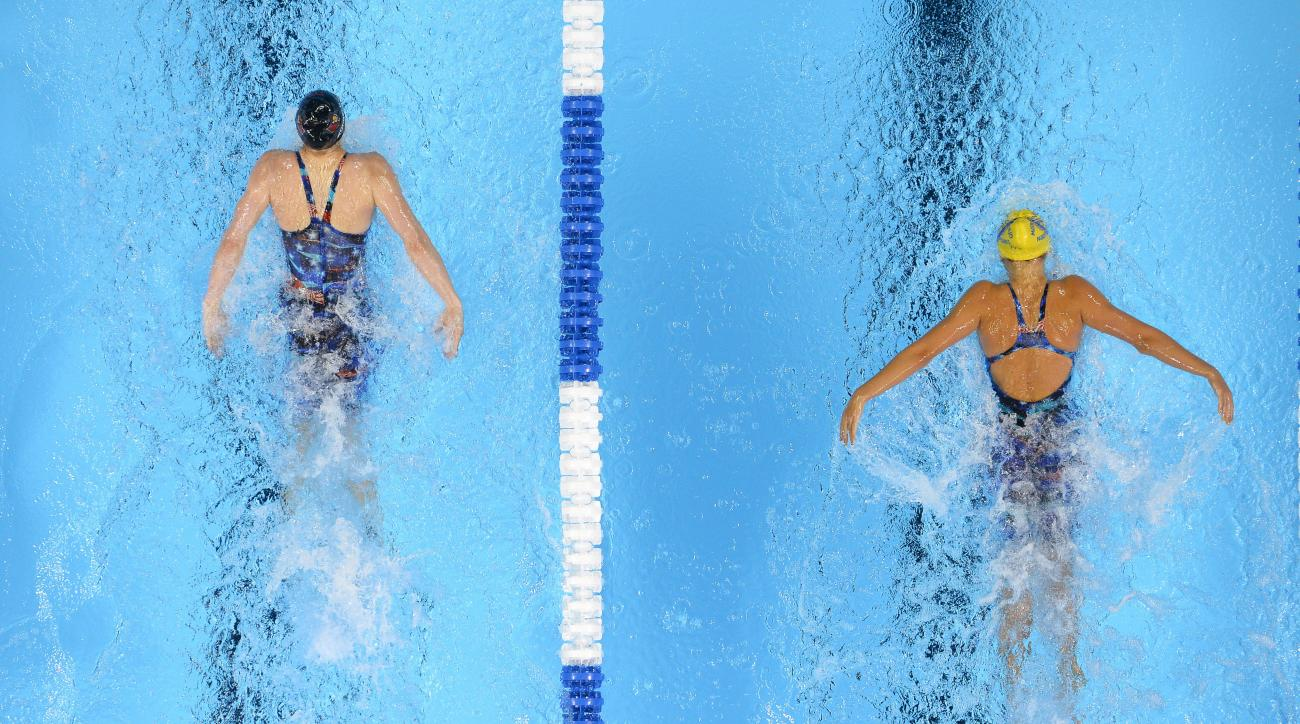 Kelsi Worrell, left, and Katie McLaughlin swim in the women's 200-meter butterfly preliminaries at the U.S. Olympic swimming trials, Wednesday, June 29, 2016, in Omaha, Neb. Worrell won the heat and McLaughlin took fourth. (AP Photo/Mark J. Terrill)