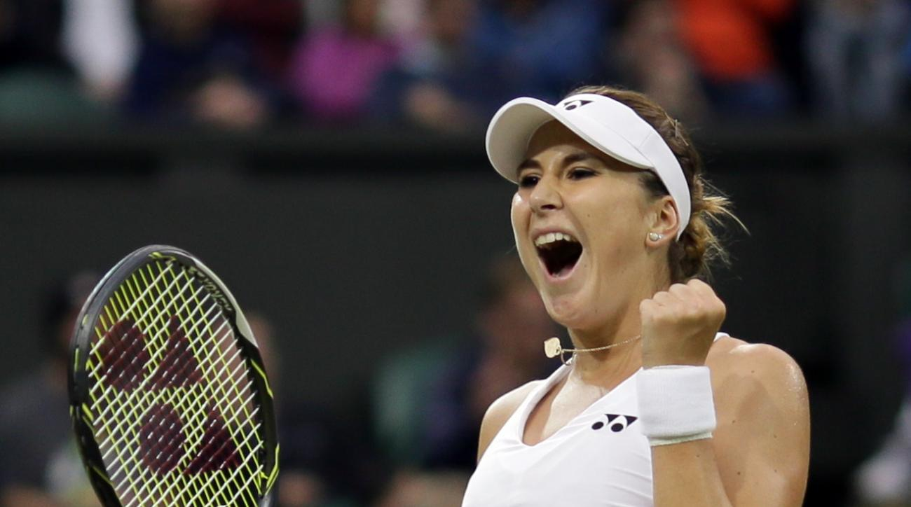 Belinda Bencic of Switzerland celebrates after beating Tsvetana Pironkova of Bulgaria during their women's singles match on day three of the Wimbledon Tennis Championships in London, Wednesday, June 29, 2016. (AP Photo/Tim Ireland)