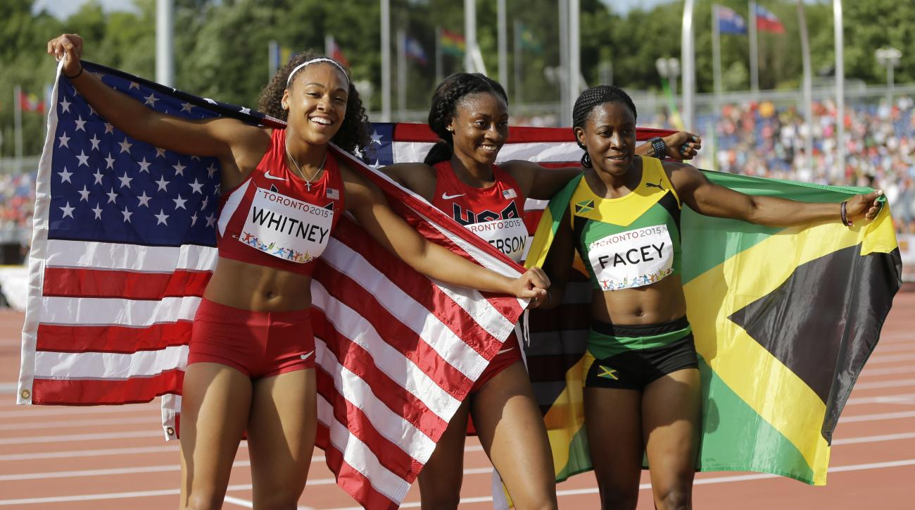 FILE - In this July 24, 2015 file photo, USA's Kaylin Whitney, from left, winning the gold medal, USA's Kyra Jefferson and Jamaica's Simone Facey celebrate after winning the finals of the women's 200 meter run at the Pan Am Games in Toronto. Jefferson won