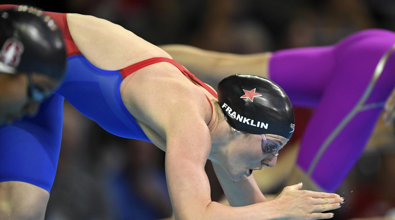 Missy Franklin dives at the start of her heat in the women's 100-meter freestyle preliminaries at the U.S. Olympic swimming trials, Thursday, June 30, 2016, in Omaha, Neb. (AP Photo/Mark J. Terrill)