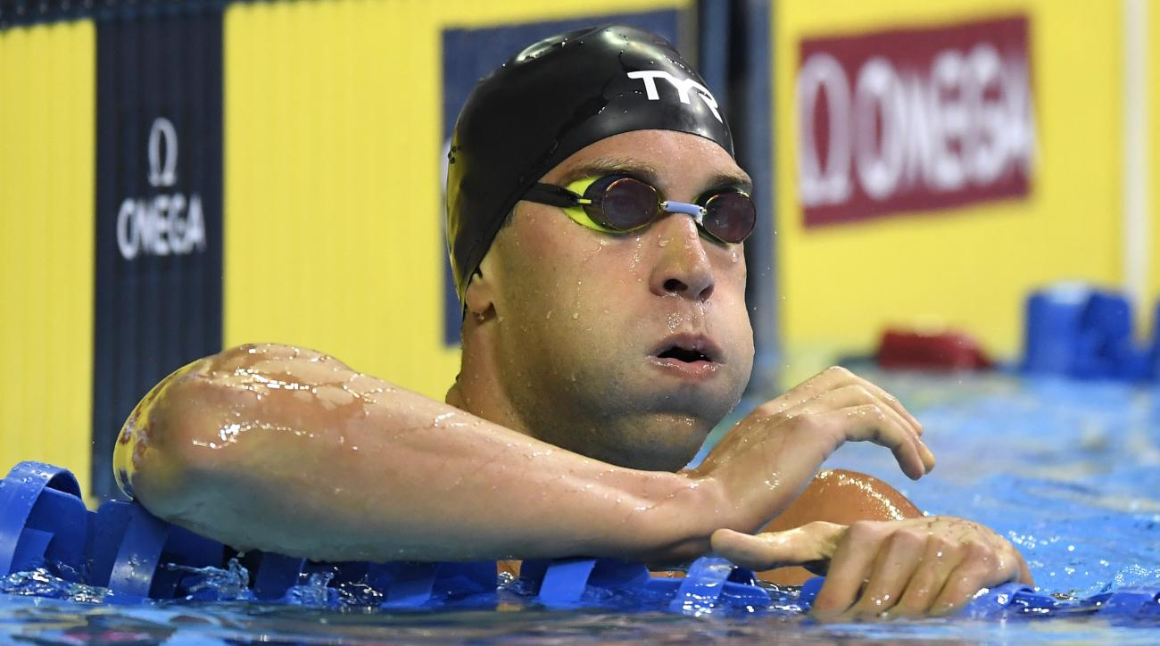 Matt Grevers checks his time after his heat in the men's 200-meter backstroke preliminaries at the U.S. Olympic swimming trials, Thursday, June 30, 2016, in Omaha, Neb. (AP Photo/Mark J. Terrill)