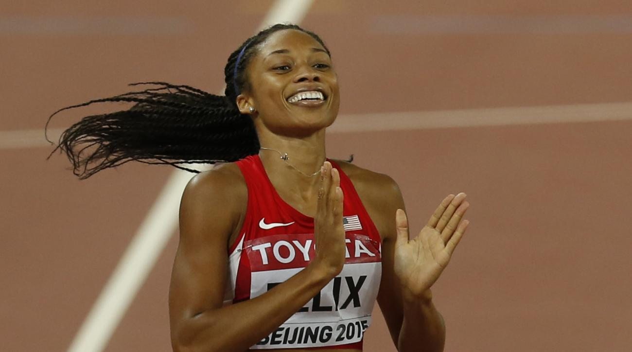 FILE - In this Aug. 27, 2015, file photo, United States' Allyson Felix celebrates after winning the gold medal in the women's 400m final at the World Athletics Championships at the Bird's Nest stadium in Beijing. Felix is supposed to be cementing her lega