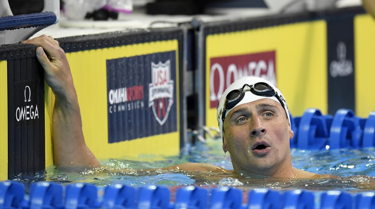 Ryan Lochte checks his time after his heat in the men's 200-meter individual medley preliminaries at the U.S. Olympic swimming trials, Thursday, June 30, 2016, in Omaha, Neb. (AP Photo/Mark J. Terrill)