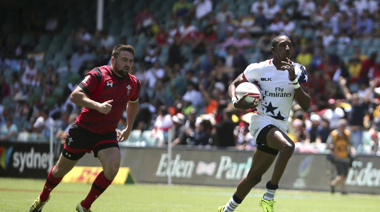 FILE - In this Feb. 6, 2016 file photo Perry Baker of U.S. right, breaks away to score a try against Wales during the World Rugby Sevens Series in Sydney, Australia. Rugby is returning to the Olympics for the first time in 92 years with a abbreviated seve