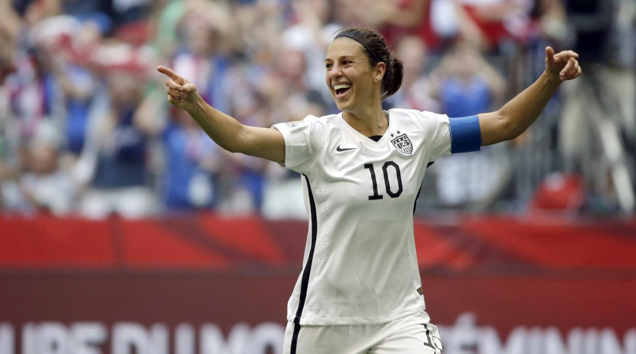 FILE - In this July 5, 2015, file photo, Carli Lloyd of the U.S celebrates scoring her third goal against Japan during the first half of the FIFA Women's World Cup soccer championship in Vancouver, British Columbia, Canada. Carli Lloyd says the time she's