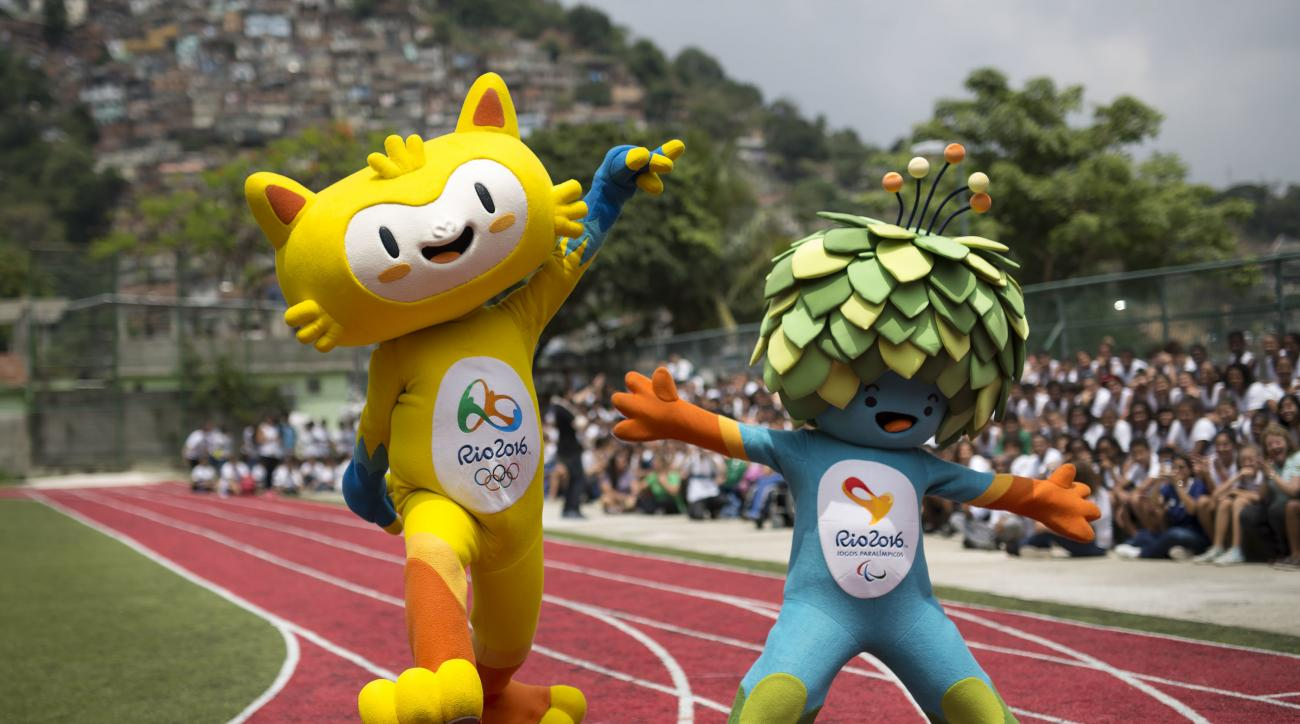 FILE - In this Nov. 24, 2014, file photo, the mascots of the Rio 2016 Olympics, left, and Paralympic Games make their first official appearance at a public school in the Santa Teresa neighborhood of Rio de Janeiro, Brazil. The Rio de Janeiro Olympics sudd