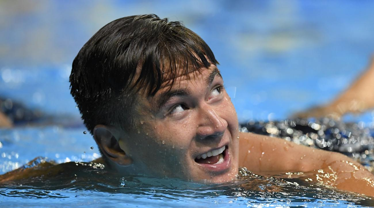 Nathan Adrian smiles after winning the mens 100-meter freestyle final at the U.S. Olympic swimming trials, Thursday, June 30, 2016, in Omaha, Neb. (AP Photo/Mark J. Terrill)