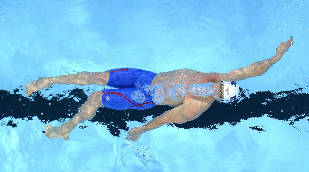 Tyler Clary swims in a men's 200-meter backstroke semifinal at the U.S. Olympic swimming trials, Thursday, June 30, 2016, in Omaha, Neb. (AP Photo/Mark J. Terrill)