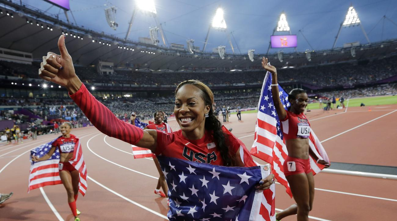 FILE- In this Aug. 11, 2012, file photo, United States' Deedee Trotter, right, Sanya Richards-Ross, front center, and Allyson Felix, back left, celebrate winning gold in the women's 4x400-meter relay final during the athletics in the Olympic Stadium at th