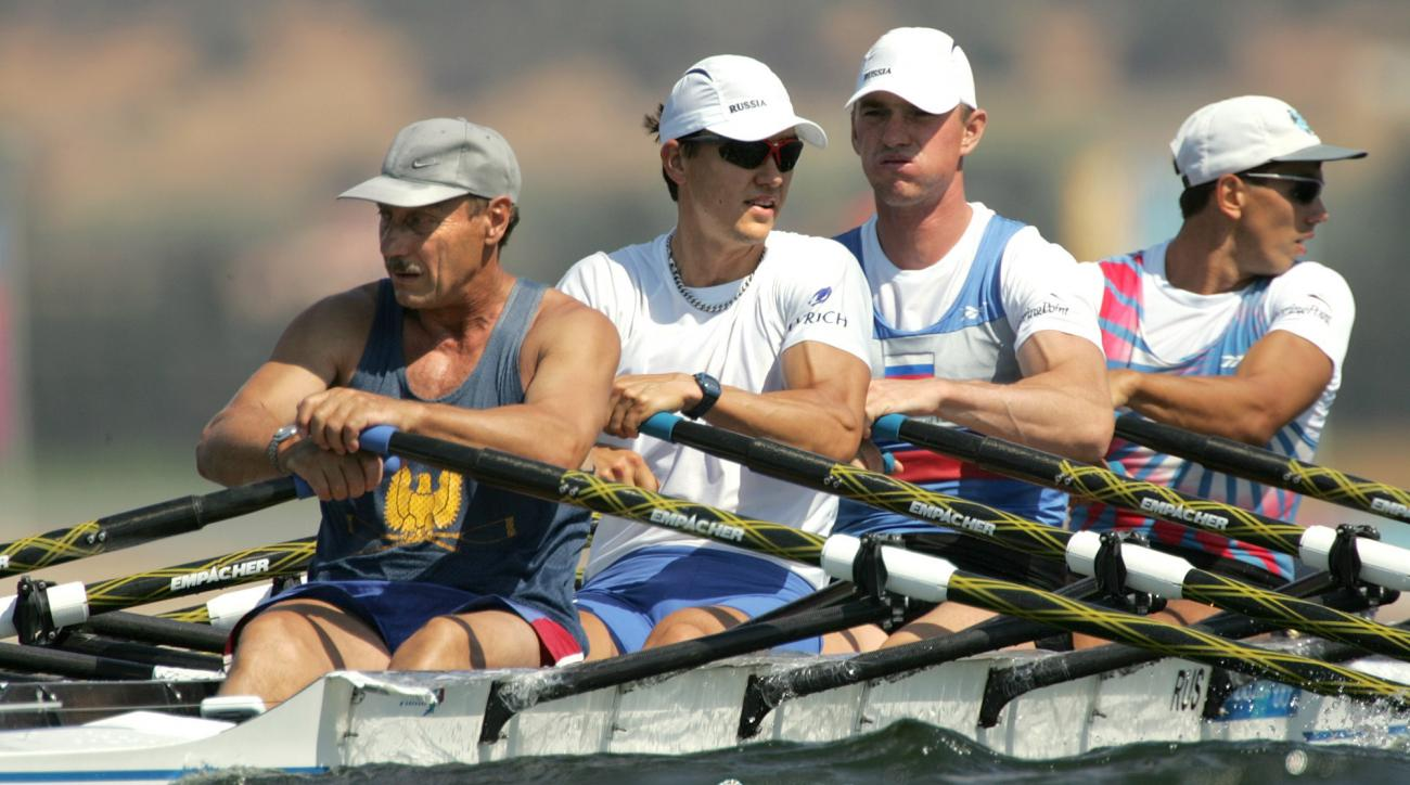 FILE-  In this file photo taken on Tuesday, Aug. 17, 2004, From left: Russia's Sergei Fedorovtsev, Alexeij Svirin, Igor Kravtsov and Nikolai Spinev train for the Men's Quad Sculls event at the 2004 Olympics Games at the Schinias Rowing & Canoeing Center i
