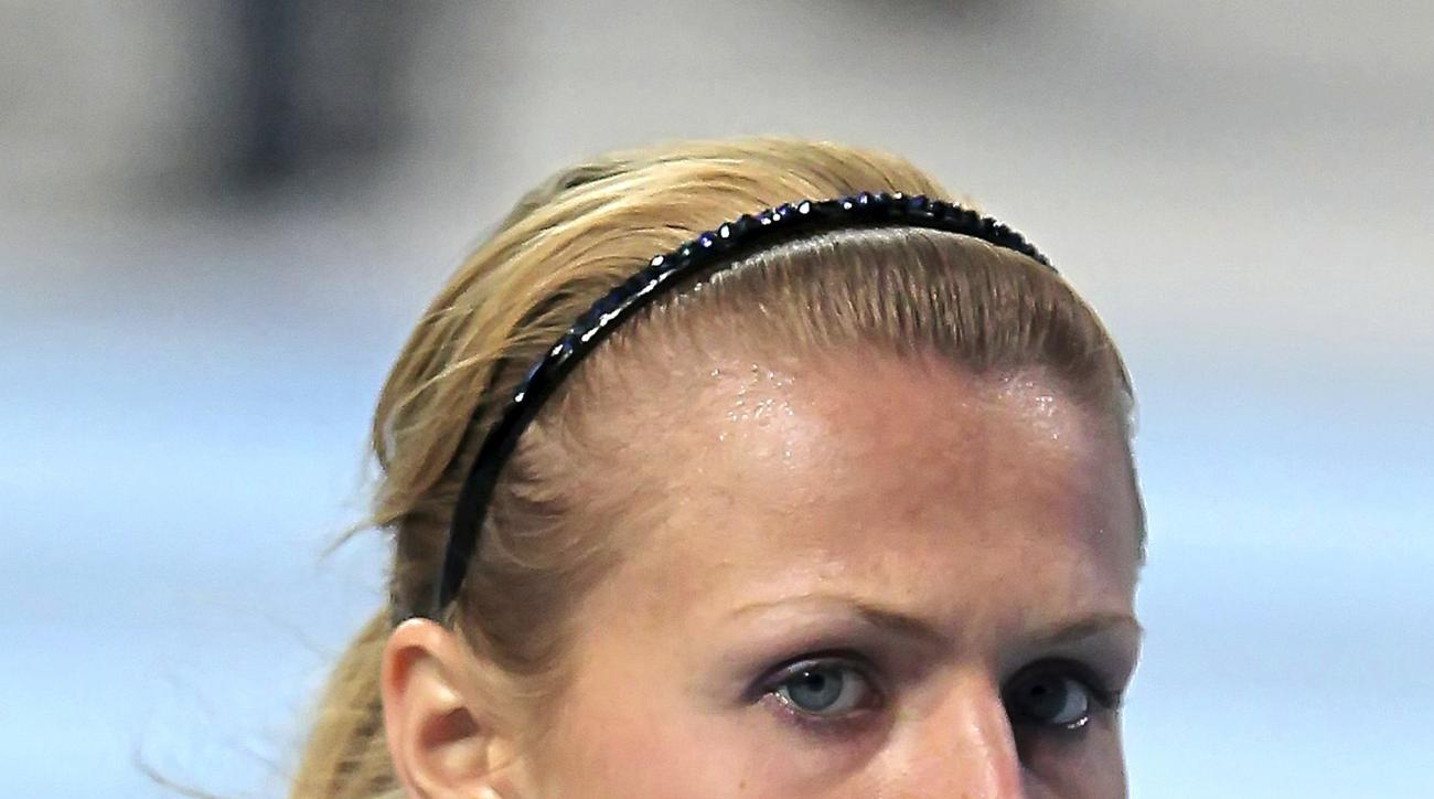 FILE - In this March 4, 2011, file photo, Yulia Stepanova poses in an undisclosed location. The IAAF has approved Russian whistleblower Yulia Stepanova's bid to compete as a neutral athlete in the European championships and the Rio de Janeiro Olympics. St