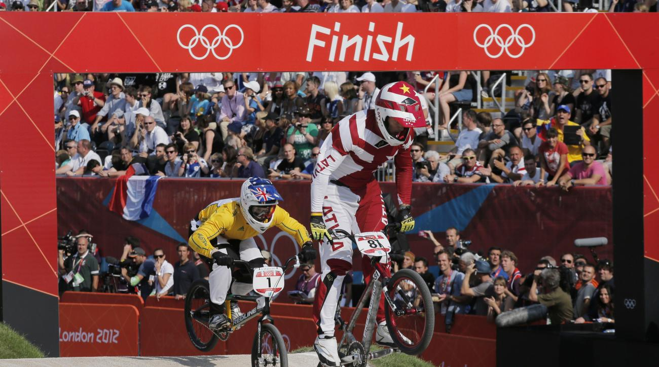 FILE - In this Aug. 10, 2012, file photo, Gold medalist Maris Strombergs, of Latvia, right, races away from silver Medalist, Sam Willoughby, of Australia, in the BMX cycling men's final run during the 2012 Summer Olympics in London. Strombergs has earned