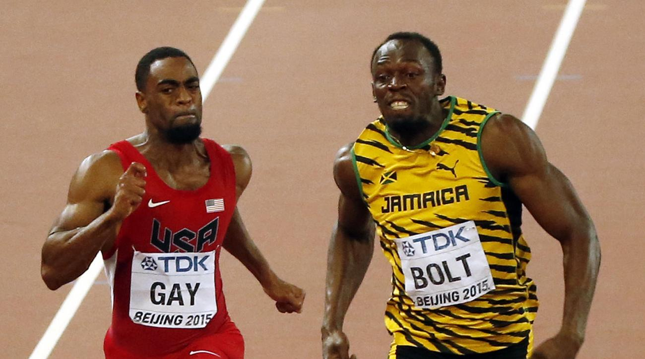 FILE - In this Aug. 23, 2015, file photo, United States' Tyson Gay trails Jamaica's gold medal winner Usain Bolt at the finish line in the men's 100-meter final at the World Athletics Championships at the Bird's Nest stadium in Beijing. The man who used t
