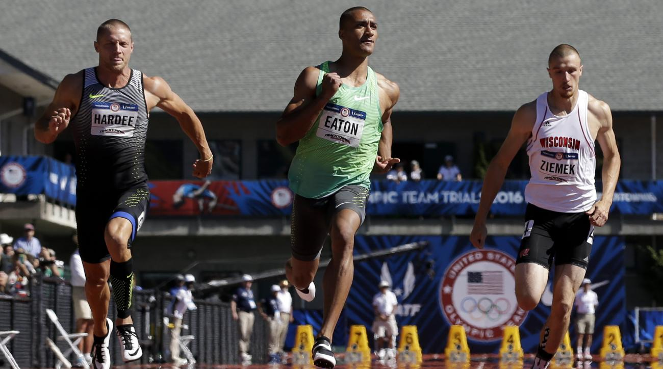 Ashton Eaton, center, wins his heat, followed by Trey Hardee in second place, left, and Zach Ziemek, in third place during the decathlon 100-meter run at the U.S. Olympic Track and Field Trials, Saturday, July 2, 2016, in Eugene Ore. (AP Photo/Marcio Jose