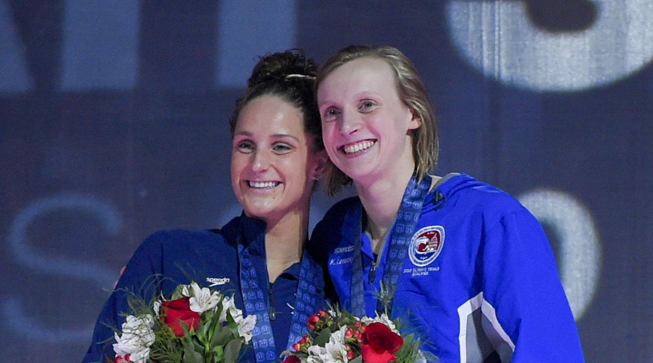 Katie Ledecky, right, and Leah Smith smile during the medal ceremony for the women's 800-meter freestyle at the U.S. Olympic swimming trials, Saturday, July 2, 2016, in Omaha, Neb. Ledecky won the race, and Smith was second. (AP Photo/Mark J. Terrill)