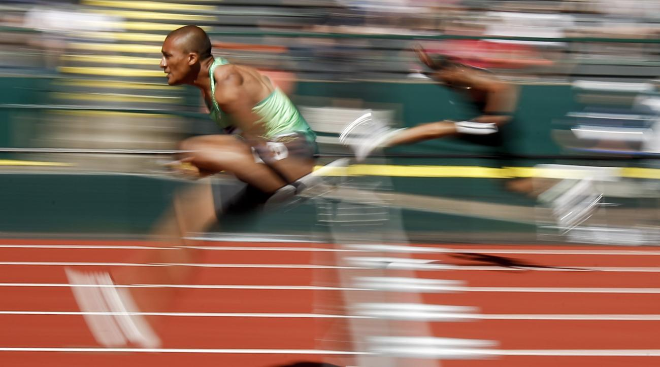 Ashton Eaton competes during the decathlon 110-meter hurdles at the U.S. Olympic Track and Field Trials, Sunday, July 3, 2016, in Eugene Ore. (AP Photo/Matt Slocum)