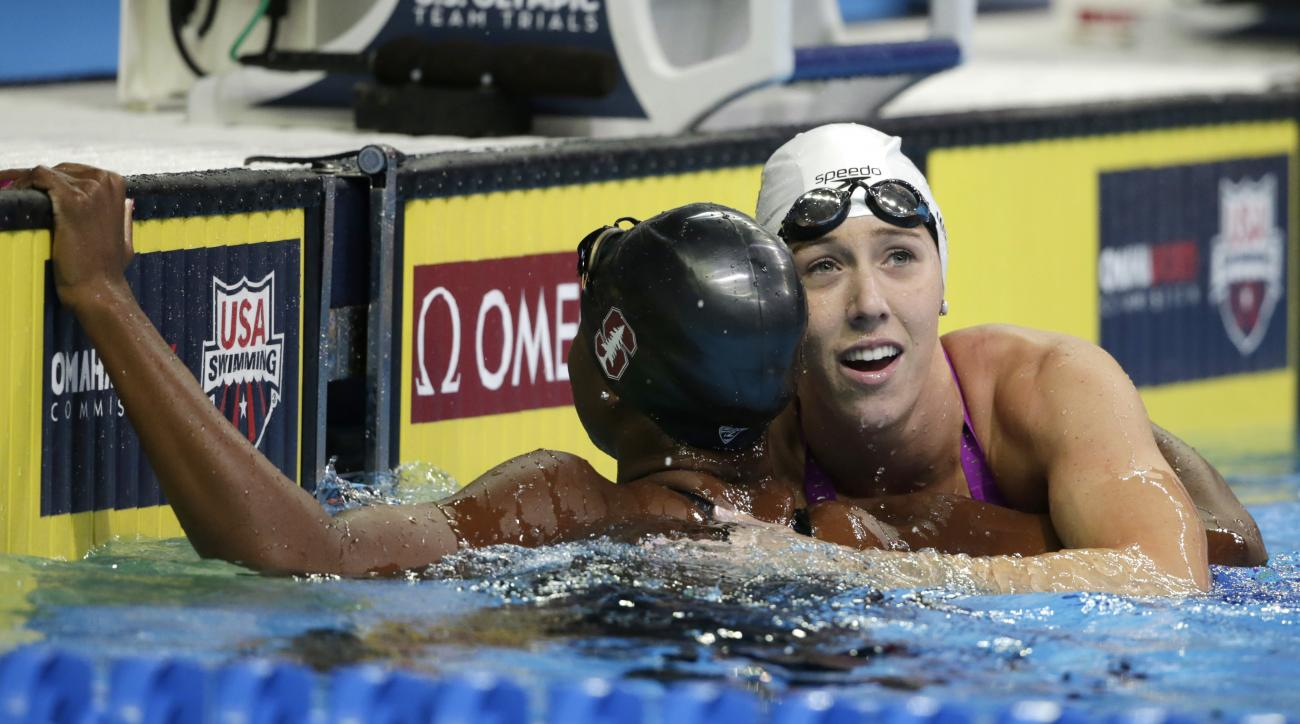 Abbey Weitzeil, right, celebrates with Simone Manuel, left, after winning the women's 50-meter freestyle final at the U.S. Olympic swimming trials, in Omaha, Neb., Sunday, July 3, 2016. (AP Photo/Nati Harnik)