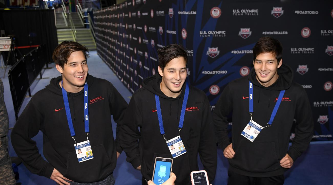 FILE - In this Saturday, July 2, 2016 file photo, Jay Litherland, from left, Kevin Litherland and Mick Litherland speak to reporters at the U.S. Olympic swimming trials in Omaha, Neb. The Litherlands left everyone seeing triple at the U.S. Olympic swimmin