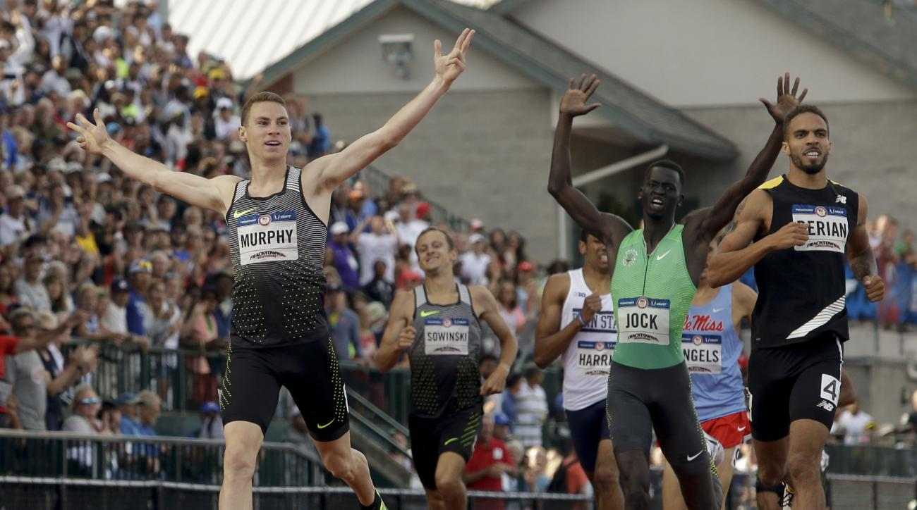 Clayton Murphy, left, winner, Boris Berian, right, in second place, and Charles Jock in third place, cross the finish line in men's 800-meter final at the U.S. Olympic Track and Field Trials, Monday, July 4, 2016, in Eugene Ore.(AP Photo/Marcio Jose Sanch