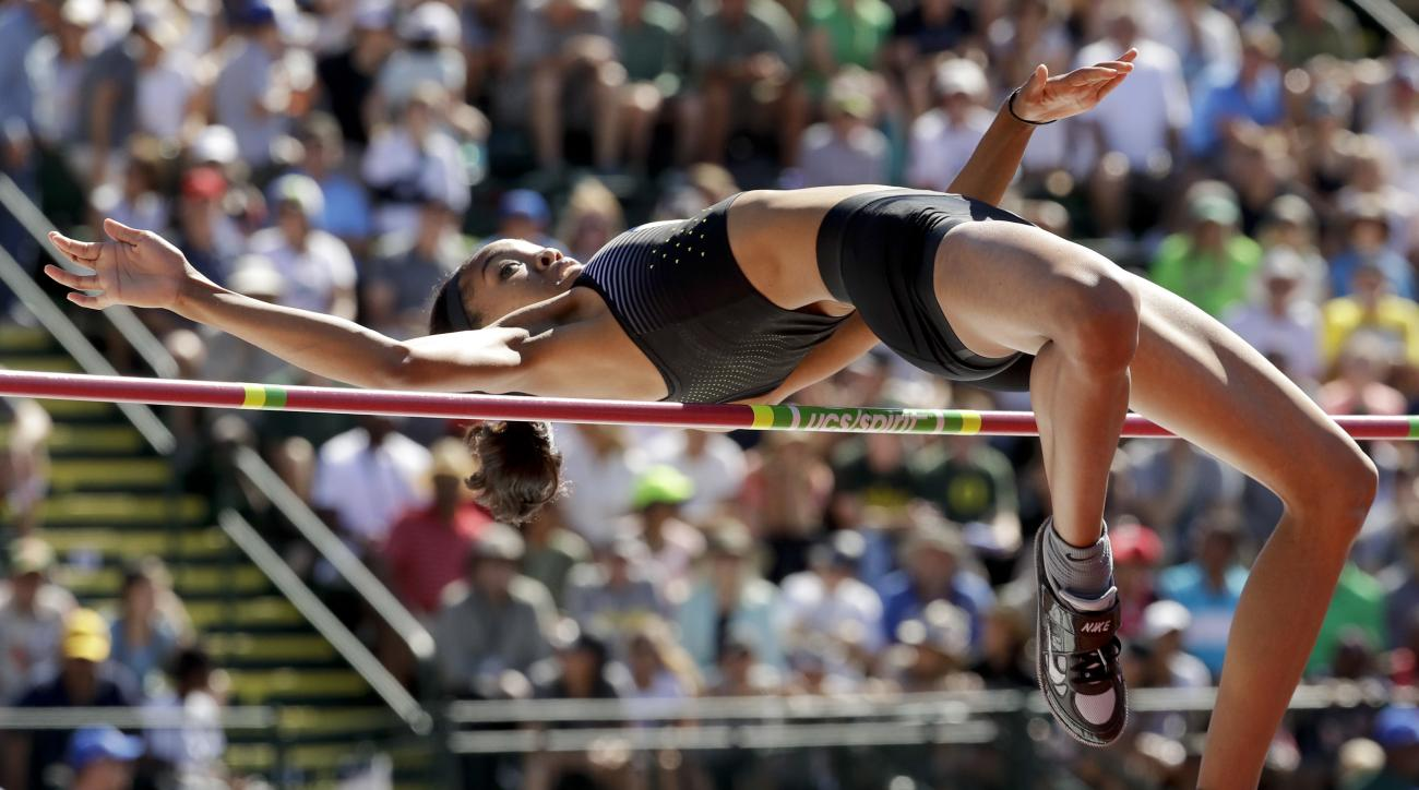 FILE - In this July 3, 2016, file photo, Vashti Cunningham clears the bar during the women's high jump final at the U.S. Olympic Track and Field Trials in Eugene Ore. Of the 50 track and field athletes who've qualified so far for the Rio Games, 35 will be