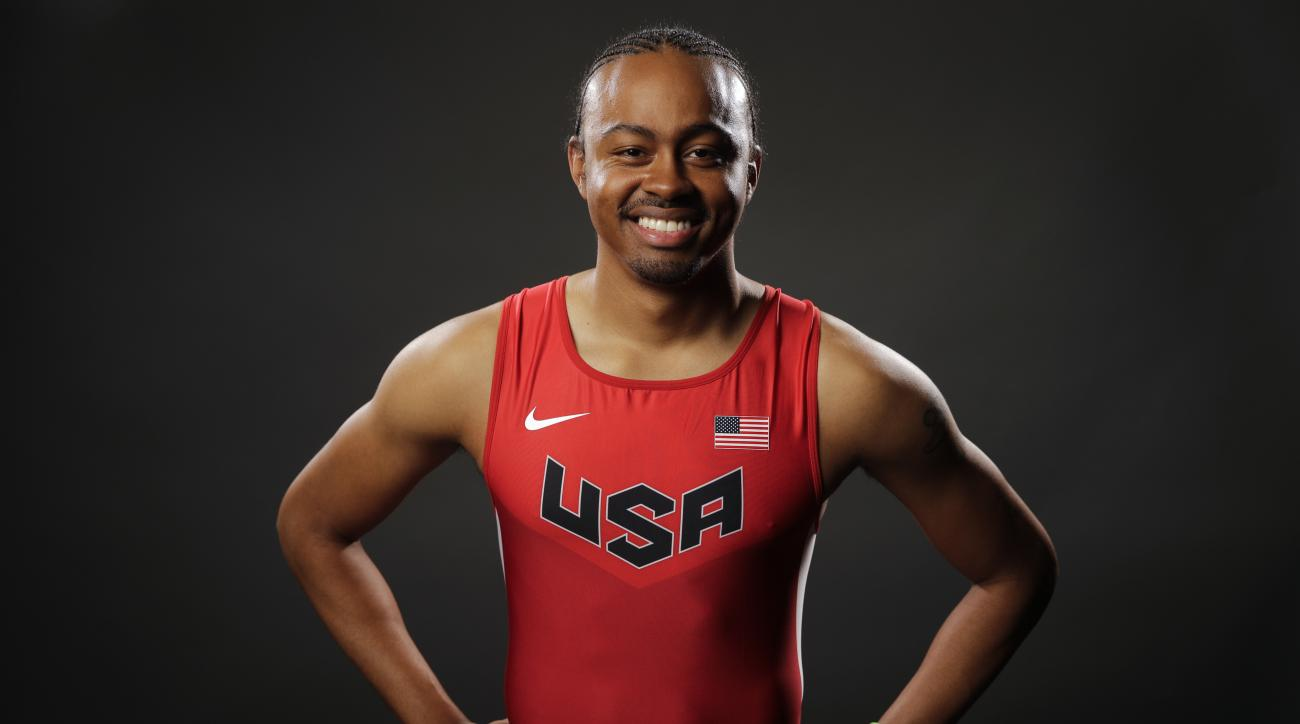 FILE - In this March 7, 2016, file photo, track and field athlete Aries Merritt poses for photos at the 2016 Team USA Media Summit in Beverly Hills, Calif. Defending Olympic champion Aries Merritt says he'll go to Brazil if he makes the U.S. team, even th