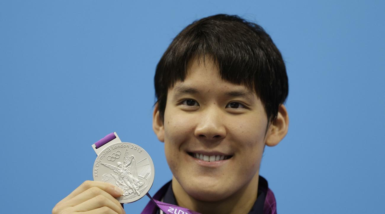 FILE- In this Monday, July 30, 2012 file photo, South Korea's Park Tae-hwan poses with his silver medal for the men's 200-meter freestyle swimming final at the Aquatics Centre in the Olympic Park during the 2012 Summer Olympics in London. South Korea's Ol