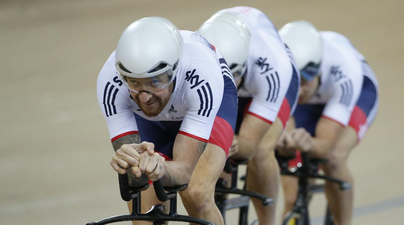 FILE - In this March 2, 2016, file photo, Britain's Bradley Wiggins leads the Men's Team Pursuit team round the track during a qualifying round at the World Track Cycling championships in London. Wiggins and Mark Cavendish hope to continue Great Britains
