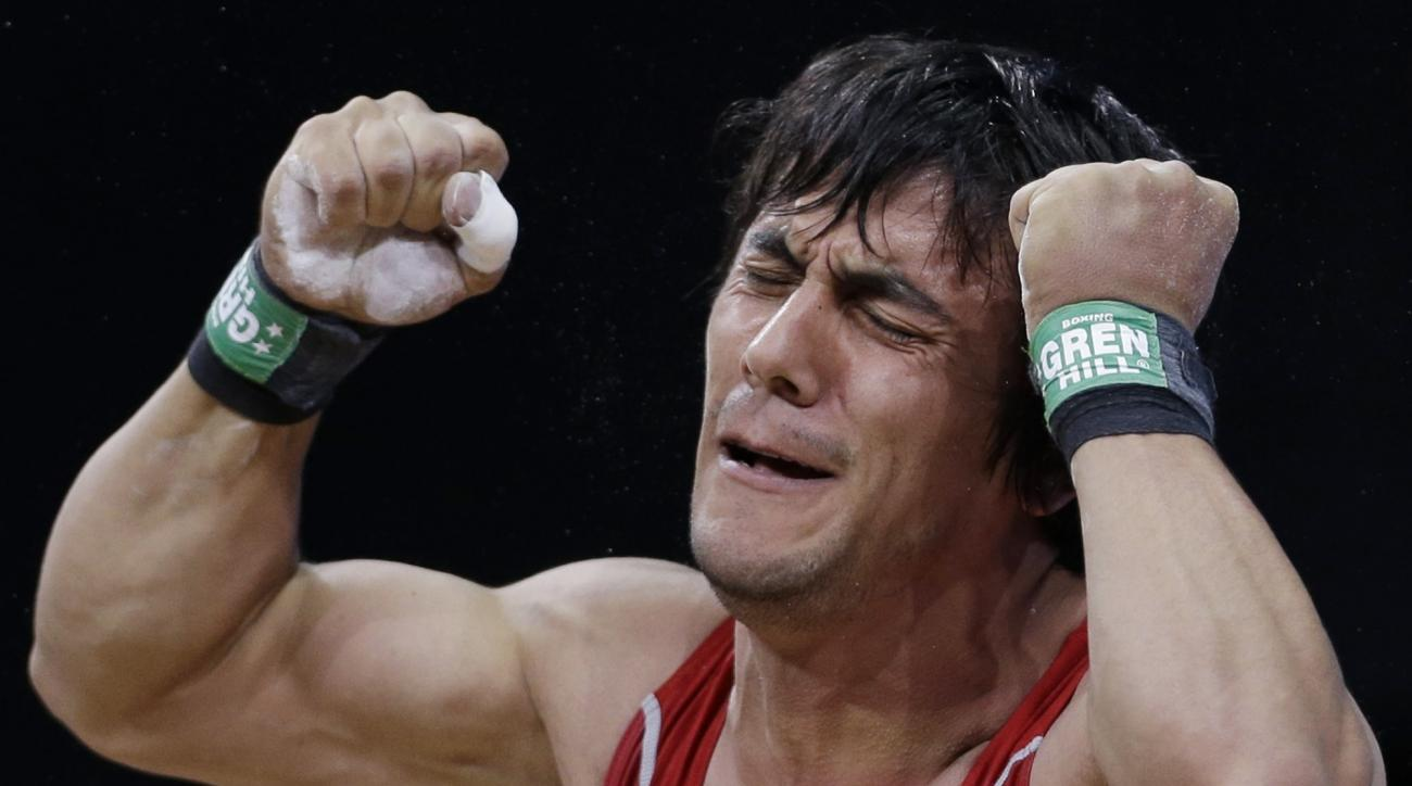 Azerbaijan's Sardar Hasanov reacts following a lift during the men's 69-kg, group B, weightlifting competition at the 2012 Summer Olympics, Tuesday, July 31, 2012, in London. (AP Photo/Hassan Ammar)