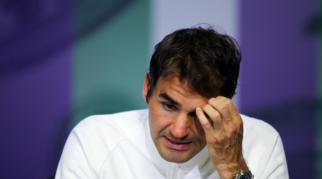 Roger Federer of Switzerland gives a press conference after being beaten in his men's semifinal singles match against Milos Raonic of Canada, on day twelve of the Wimbledon Tennis Championships in London, Friday, July 8, 2016. (Gary Hershorn/Pool Photo vi