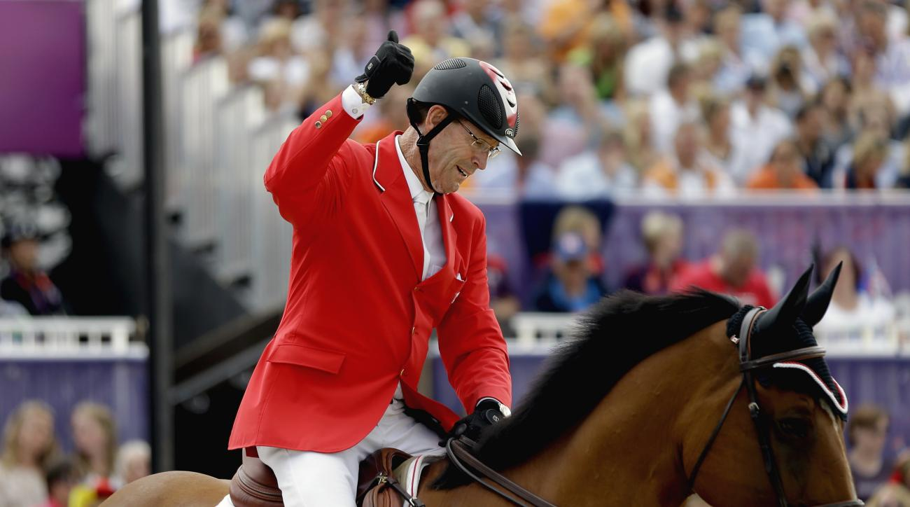 FILE - A Wednesday, Aug. 8, 2012, file photo showing Ian Millar, of Canada, giving a thumbs up after riding his horse Star Power, during the equestrian individual show jumping competition at the 2012 Summer Olympics, in London. Known as Captain Canada, Ia