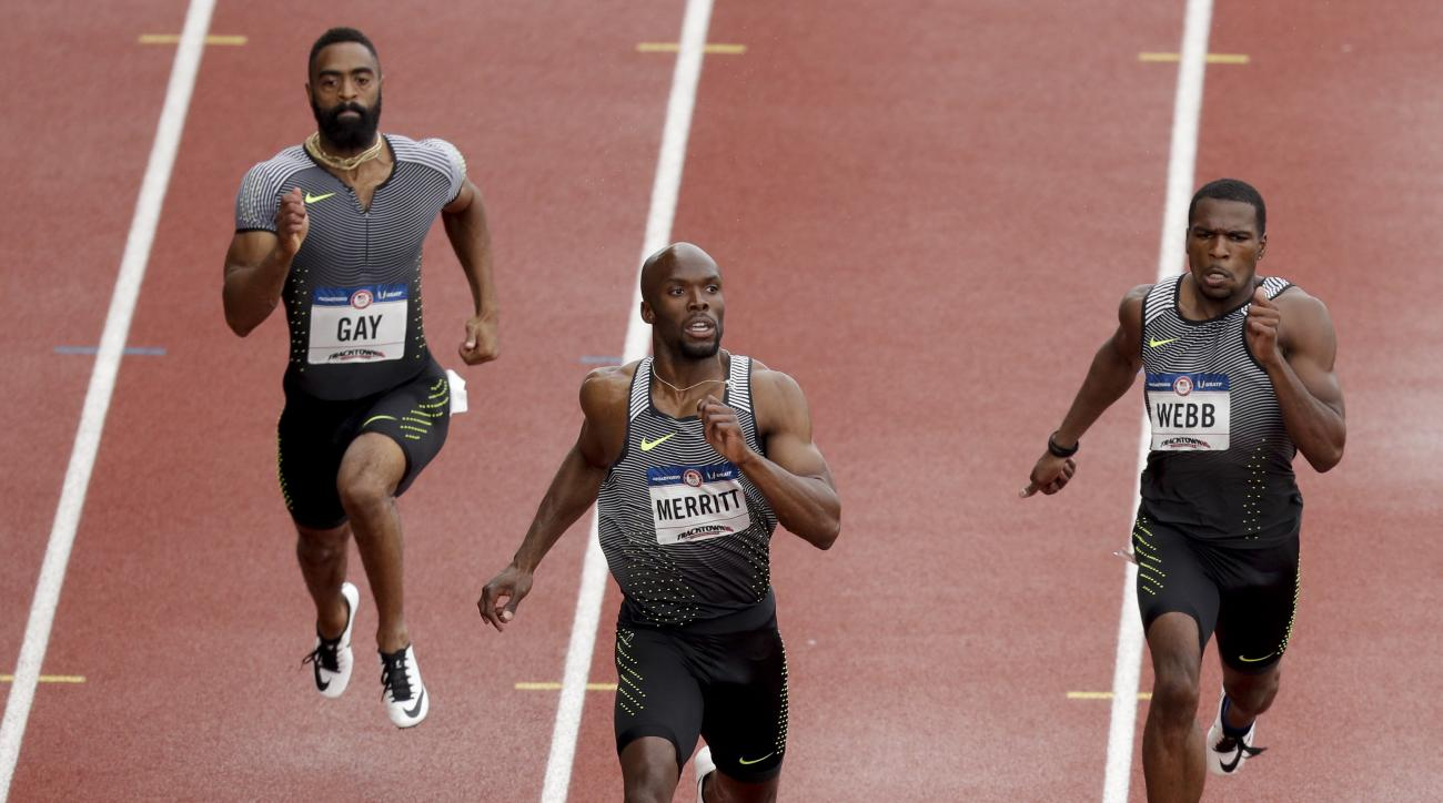 LaShawn Merritt, middle, second place Ameer Webb, right, and third place Tyson Gay finish during the semifinals in the mens 200-meter run at the U.S. Olympic Track and Field Trials, Friday, July 8, 2016, in Eugene Ore. (AP Photo/Charlie Riedel)