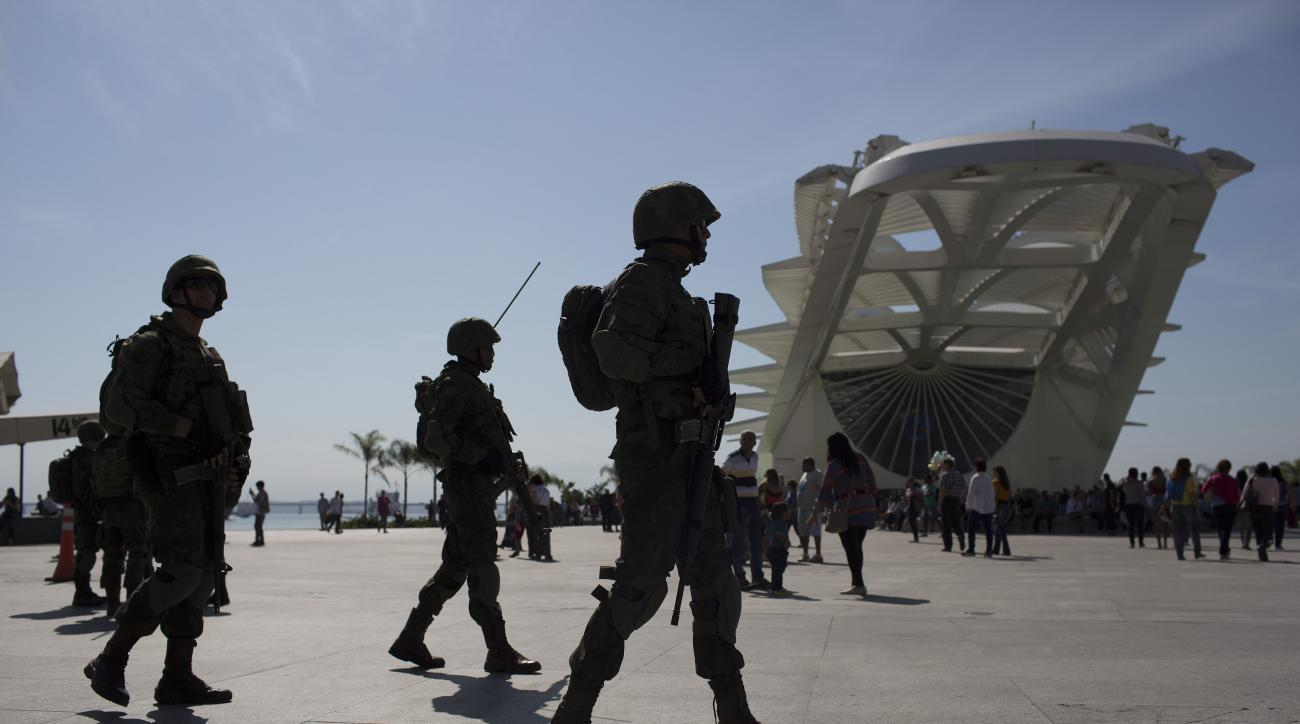Soldiers patrol outside the Museum of Tomorrow in Rio de Janeiro, Brazil, Saturday, July 9, 2016. Roughly twice the security contingent at the London Olympics will be deployed during the August games in Rio, which are expected to draw thousands of foreign
