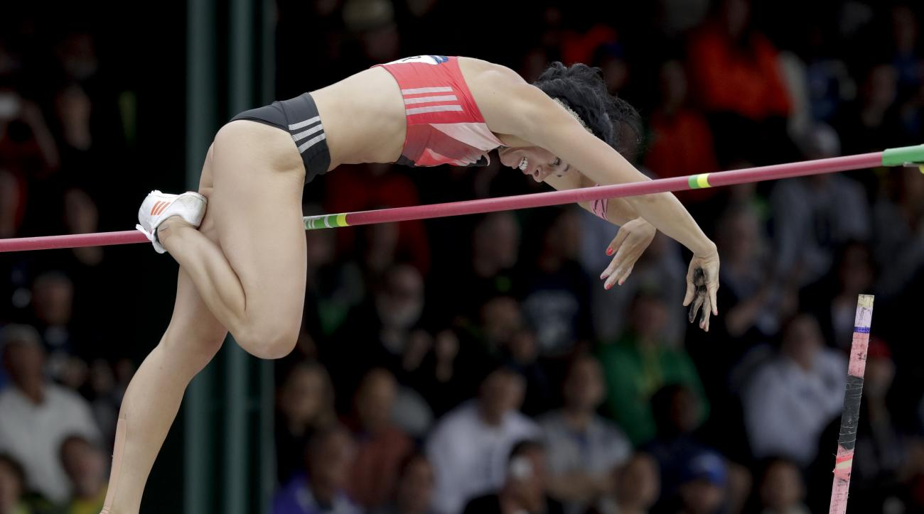 Jenn Suhr clears the bar during the women's pole vault final at the U.S. Olympic Track and Field Trials, Sunday, July 10, 2016, in Eugene Ore. (AP Photo/Charlie Riedel)