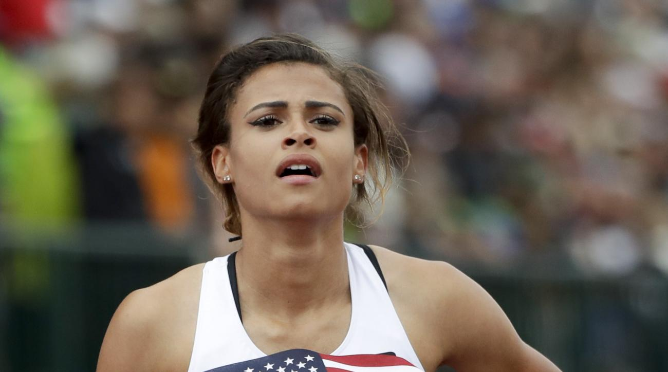Sydney McLaughlin reacts to her third place finish in the finals of the women's 400-meter hurdles at the U.S. Olympic Track and Field Trials, Sunday, July 10, 2016, in Eugene Ore.  (AP Photo/Marcio Jose Sanchez)