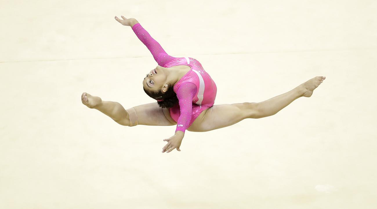 Lauren Hernandez competes on the floor exercise during the women's U.S. Olympic gymnastics trials in San Jose, Calif., Sunday, July 10, 2016. (AP Photo/Gregory Bull)