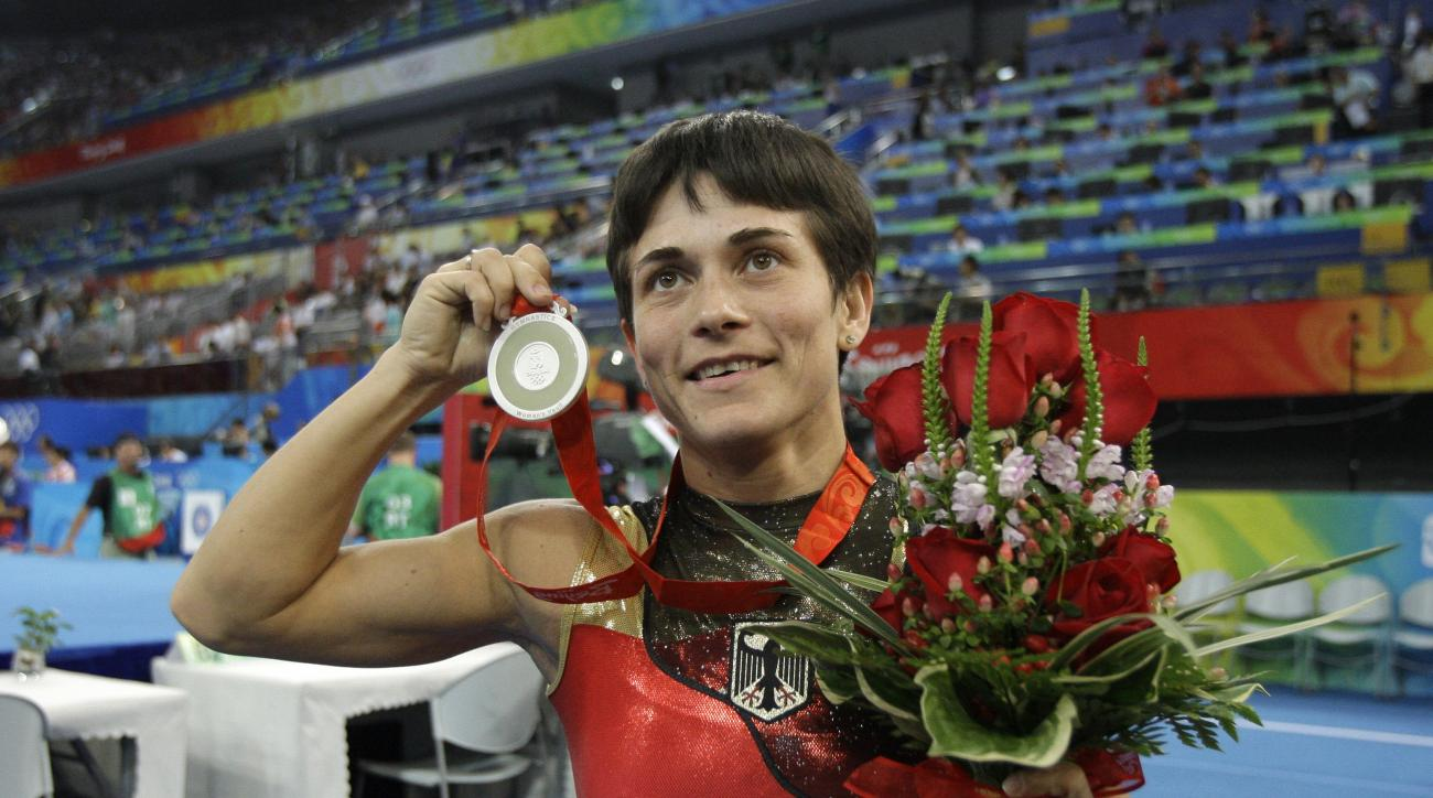 FILE - In this Aug. 17, 2008 file photo Germany's gymnast Oksana Chusovitina poses after winning the silver medal during the women's vault apparatus finals at the Beijing 2008 Olympics in Beijing. Chusovitina will compete at her seventh Olympics when she