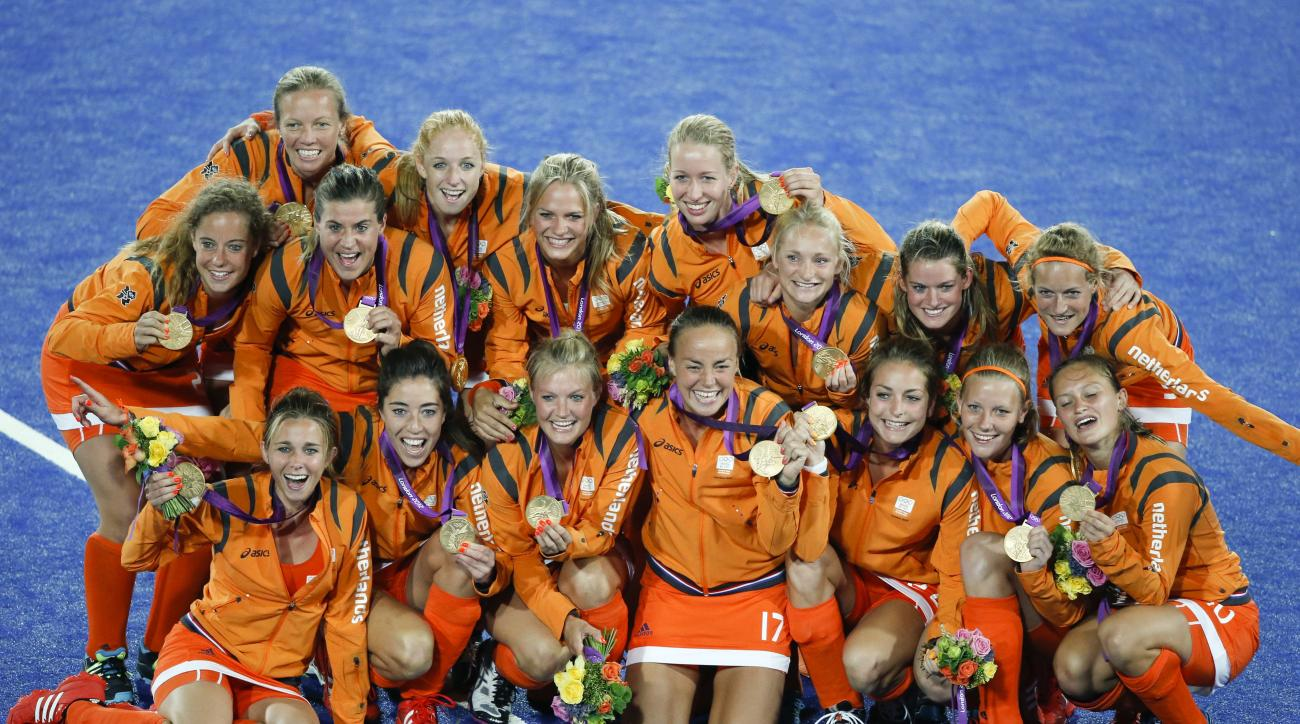 FILE - In this Aug. 10, 2012, file photo, the Netherlands' players pose with their gold medals after defeating Argentina in a women's field hockey match at the Summer Olympics, in London. The womens team is seeking its third consecutive Olympic gold medal