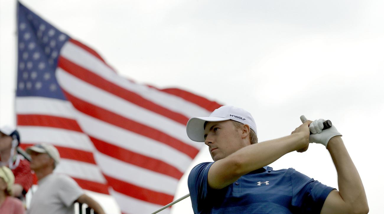 FILE - In this June 16, 2016, file photo, Jordan Spieth watches his tee shot on the third hole during the first round of the U.S. Open golf championship at Oakmont Country Club in Oakmont, Pa. Spieth is out of the Olympics. International Golf Federation p