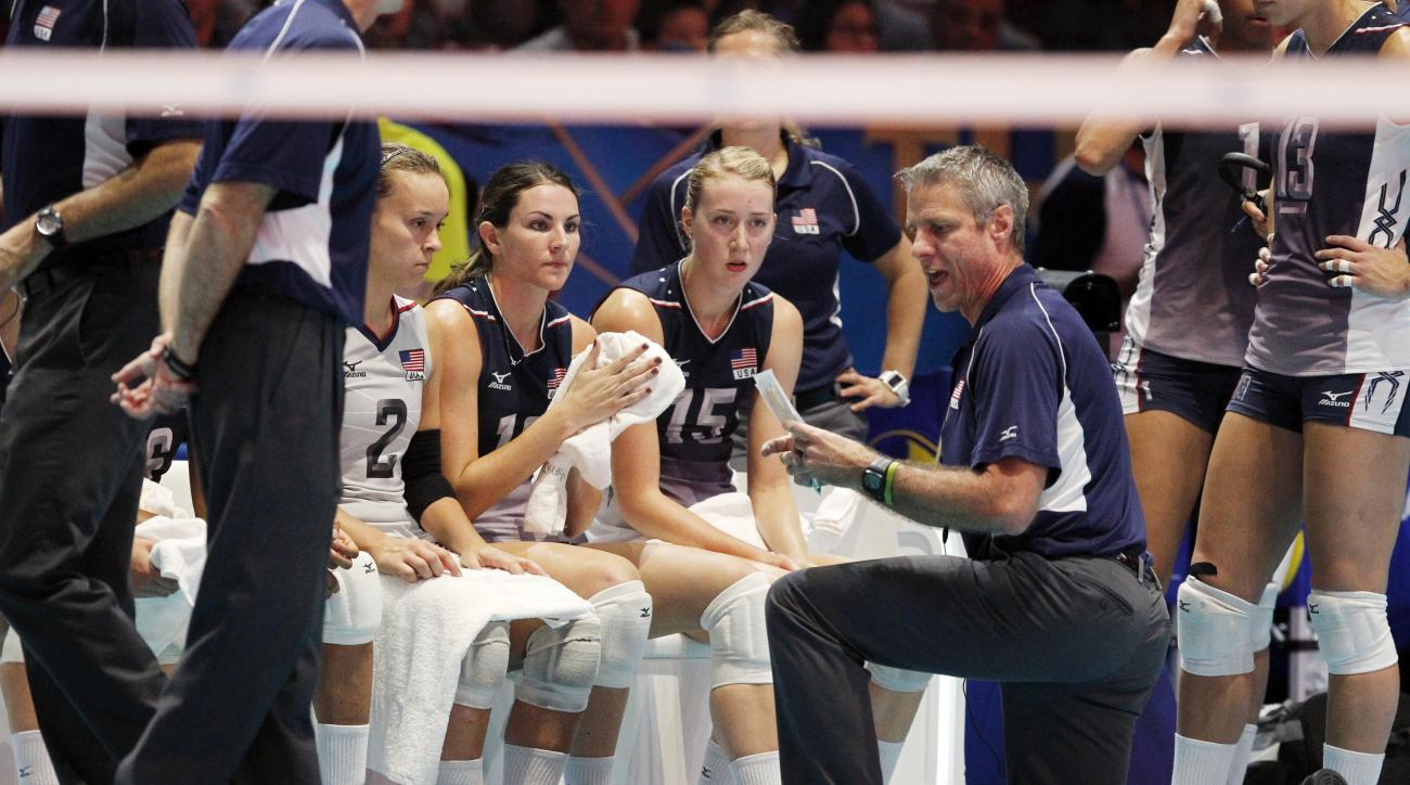 USA's coach Karch Kiraly gives instructions during a semifinal volleyball match between United States and Brazil, at the women's Volleyball World Championships in Milan, Italy, Saturday, Oct. 11, 2014. (AP Photo/Felice Calabro')