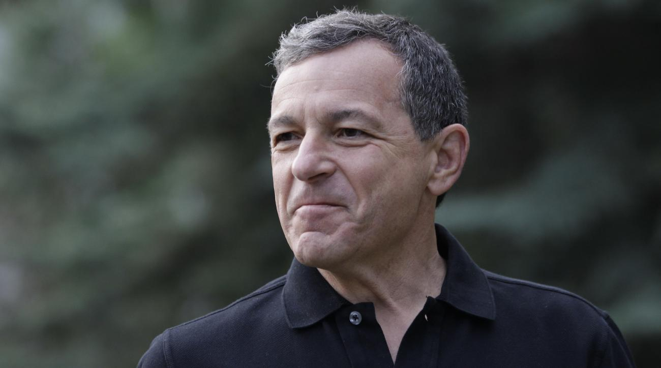 "FILE - In this July 13, 2012, file photo, Robert A. ""Bob"" Iger, chairman and CEO of The Walt Disney Co., attends the Allen & Company Sun Valley Conference in Sun Valley, Idaho. Iger is joining Los Angeles' bid to land the 2024 Olympics. He will serve as a"